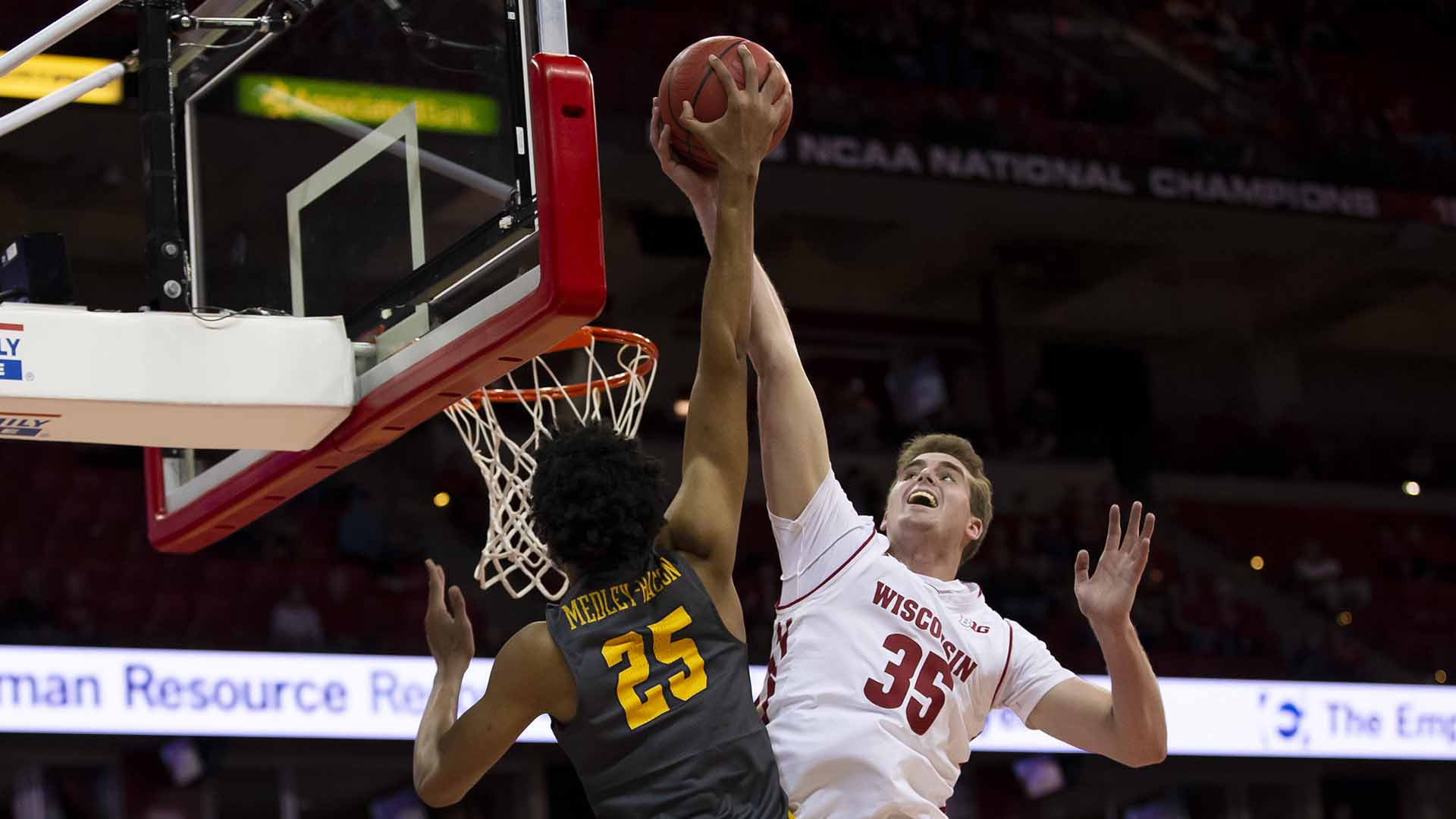 November 6, 2018: Wisconsin Badgers forward Nate Reuvers #35 blocks the shot of Coppin State Eagles center Brendan Medley-Bacon #25 late in the game during the NCAA Basketball game between the Coppin State Eagles and the Wisconsin Badgers at the Kohl Center in Madison, WI. Wisconsin defeated Coppin State 85-63. John Fisher/CSM(Credit Image: © Cal Sport Media)